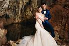 Nicky Wu and Liu Shishi chose to get pre-wedding photographs taken at the Waitomo Glowworm Caves. Photo / Liu Zongyuan