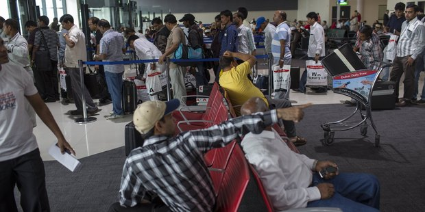 Passengers waiting to board their plane at Dubai International Airport. Photo / Getty