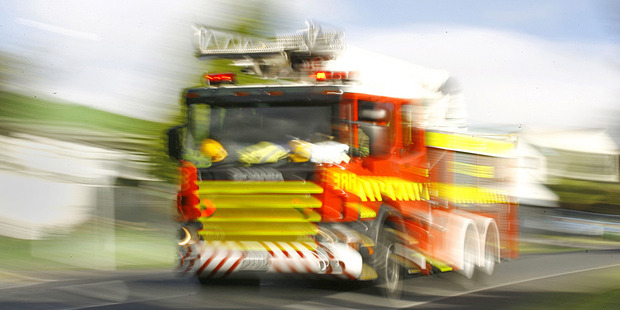 Fire crews are working to free one person who is trapped in a car. Photo / Supplied