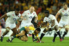 Christian Lealiifano of Australia is smothered by the England defence during the test match between England and Australia on June 11, 2016. Photo / Getty