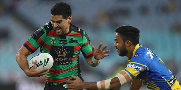 Cody Walker of the Rabbitohs beats the tackle of Bevan French of the Eels during the round 15 NRL match between the South Sydney Rabbitohs and the Parramatta Eels. Photo / Getty Images