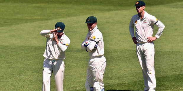 Australian skipper Steve Smith calls for a DRS review. Photo / Getty