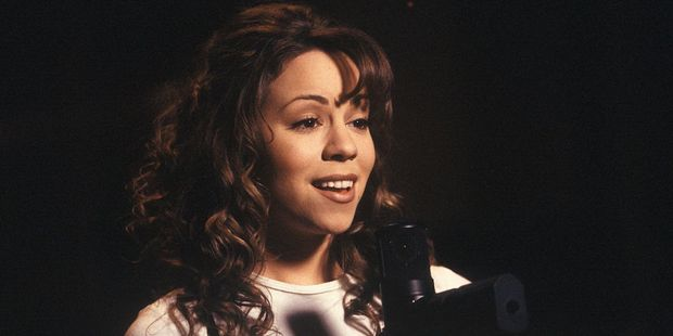 'Who does your hair and make-up?' is what Mariah Carey says when she thinks about her 1990's fashion. Photo / Getty Images