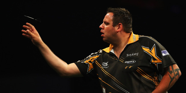 Adrian Lewis of England plays a shot in his match against Gary Anderson. Photo / Getty Images