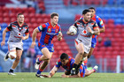 Isaac Luke of the Warriors runs the ball against the Newcastle Knights. Photo / Getty Images