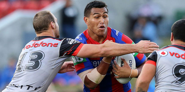 Daniel Saifiti of the Knights is tackled by the Warriors defence. Photo / Getty