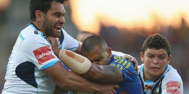 Konrad Hurrell attempts a tackle in the Titans' loss to the Eels. Photo / Getty