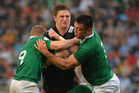 Jordie Barrett of New Zealand gets stuck in an Irish tackle in Manchester last night (NZT). Photo / Getty Images