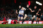 Ben Smith making a break during the Test match between the New Zealand All Blacks and Wales at Eden Park. Photo / Getty Images