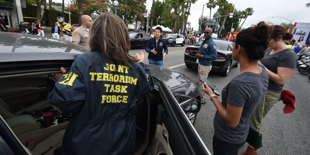 Members of the FBI Joint Terrorism task force stand by to provide security for the 2016 Gay Pride Parade June 12, 20116 in Los Angeles. Photo / Getty