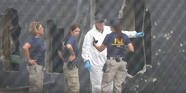 Loading FBI agents investigate near the damaged rear wall of the Pulse Nightclub. Photo / Getty Images