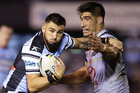 Jack Bird of the Sharks takes on the defence. Photo / Getty Images