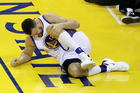 Andrew Bogut holds his knee in pain after sustaining an injury. Photo / Getty Images