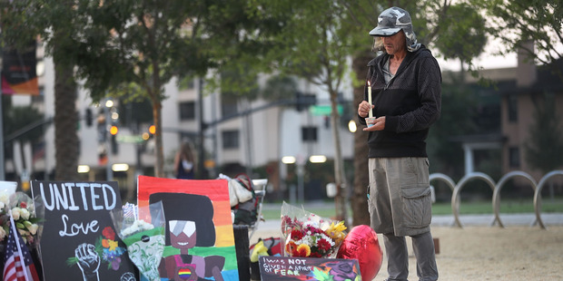 Loading Tony Backe pays his respects at a memorial in front the Dr. Phillips Center for the Performing Arts to the victims of the Pulse gay nightclub shooting. Photo / Getty