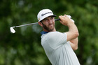 Dustin Johnson hits a shot during a practice round prior to the U.S. Open. Photo / Getty Images