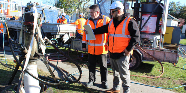 PipeWorks site supervisor Dez Malio, right, shows Rotorua Lakes Council contract supervisor Geoff Kitson how the inversion technology using resin works. Photo/Supplied