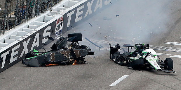 Josef Newgarden crashes after contact with Conor Daly. Photo / Getty Images