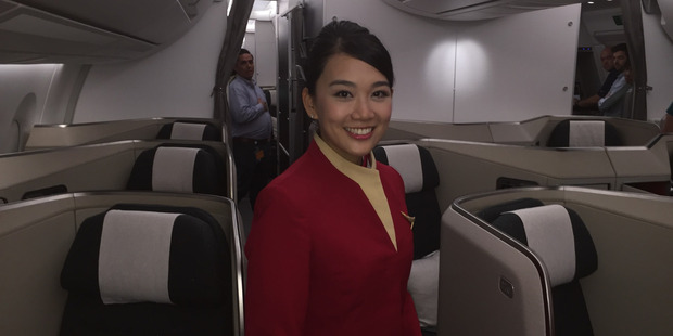 Loading Cathay Pacific crew member in the business class cabin on the A350. Photo / Grant Bradley