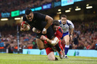 Julian Savea (L)of the All Blacks scores his sides opening try despite the challenge from Alex Cuthbert (R) of Wales. Photo / Getty Images.