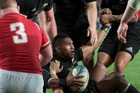 YOU GOT IT: Expat Whanganui representative Waisake Naholo is lifted up by his delighted All Blacks teammates after bulldozing over for the cruicial try in the victory of Wales.