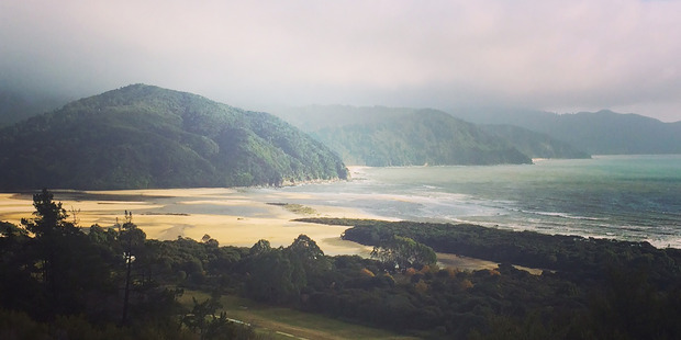 The sun comes out over Awaroa Inlet, in Abel Tasman National Park.