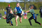 Jazmin Spice of Papamoa Primary School on attack against Kawerau South School in the Year 5-6 final at the Bay of Plenty rippa rugby finals. Photo / George Novak