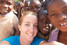 Sally Angelson with children in Mumbwa, Zambia, where the first ATLAS pilot was conducted. Photo / Supplied