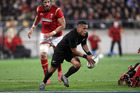 Aaron Smith makes a break during the second test against Wales. Photo / Getty Images