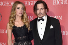 Johnny Depp (right) has reportedly broken his restraining order from Amber Heard. Photo / AP