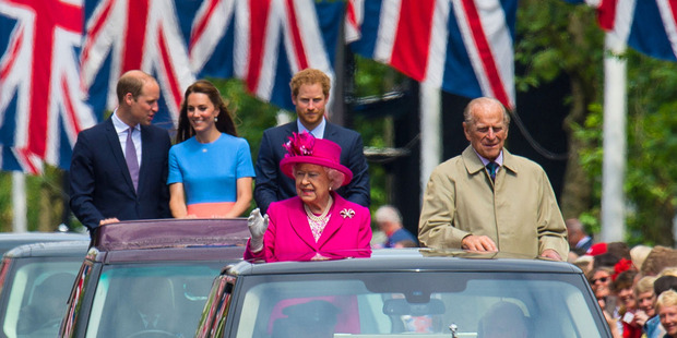 Queen Elizabeth and the Duke of Edinburgh lead a convoy of cars carrying the Duke and Duchess of Cambridge and Prince Harry along the Mall, in central London, during the Patron's Lunch. Photo / AP