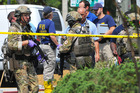 FBI, Orlando Police Department and the Orange County Sheriff's Office personnel investigate the attack at the Pulse nightclub in Orlando. Photo / AP
