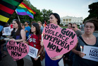 Rachel Henry, Selene Arciga, Nicolette Gullickson, Joanna Lamstein join members and supporters of the LGBT as they gather for a candlelight vigil in front of the White House in Washington. Photo / AP