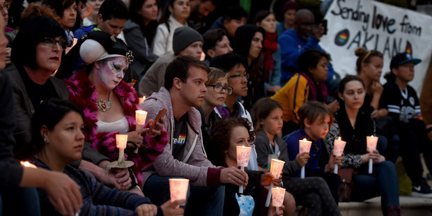 Loading Victims of the Orlando shooting are honored and remembered during an Oakland Out for Orlando community Vigil held at city hall. Photo / AP