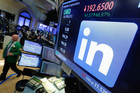 The LinkeIn logo appears on a screen at the post where it trades on the floor of the NYSE. Microsoft has surprised the market by saying it will buy the business networking site. Photo / AP