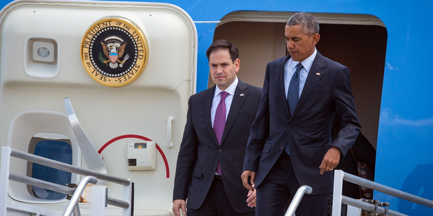 President Barack Obama, right, and Senator Marco Rubio, left, get off Air Force One at Orlando International Airport in Orlando, Florida. Photo / AP