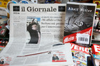 Il Giornale newspaper is seen on sale in a newsstand with Hitler's Mein Kampf. Photo / AP