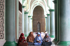 Muslim women read the Quran in Indonesia. Photo / AP