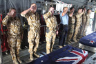 Kiwis pay their respects during the ramp ceremony for LCPL Pralli Durrer and LCPL Rory Malone at Bagram Air Force Base. Photo / Supplied