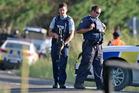 Police at the scene of the siege near Kawerau in March where an officer was shot. PHOTO/BEN FRASER