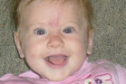 Emily Saunders, 2, was swept away in the flooded Poerua River. Searchers are still looking for her.  Photo / Facebook