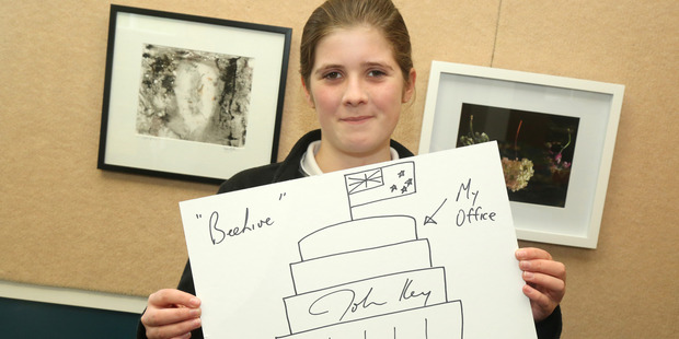 Turakina student Isabella Ford, 12, with the Prime Minister's contribution to the art auction. Photo/Bevan Conley