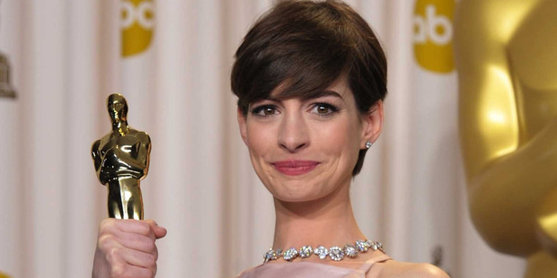 Anne Hathaway poses with her award for best actress in a supporting role. Photo / AP