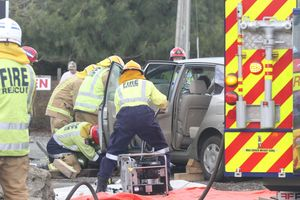 Fire crews block up the wrecked car and secure it.