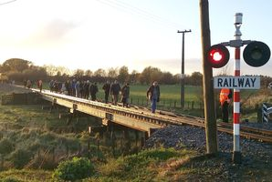 Wairarapa commuters had to walk the tracks yesterday after the morning train broke down south of Carterton. PHOTO/JOHN MCMULLAN