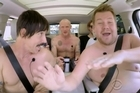 James Corden gets his kit off with the Red Hot Chili Peppers and hears them sing a bizarre unreleased song in the latest episode of Carpool Karaoke. Source: CBS