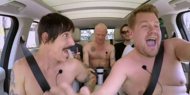 Loading James Corden takes a topless ride with The Red Hot Chili Peppers. Photo / YouTube