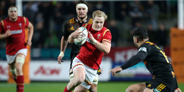 Loading Aled Davies of Wales (C) makes a clear break during the rugby union match between the Super Rugby team Waikato Chiefs and Wales. Photo / Getty Images.