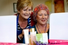 Beautician Karen Thomas takes Dee Myhre through some beauty steps. Ms Thomas has volunteered her services since the Whangarei scheme started, and is one of seven women in the role. Photo / John Stone