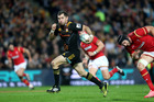 32-year-old Stephen Donald of the Chiefs splits the Welsh defence on Tuesday night. Photo / Getty Images