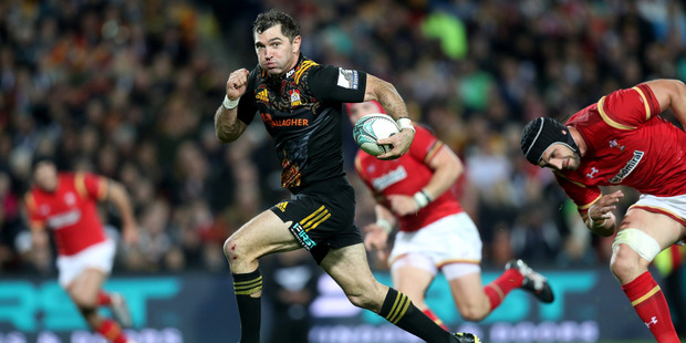 Loading 32-year-old Stephen Donald of the Chiefs splits the Welsh defence on Tuesday night. Photo / Getty Images